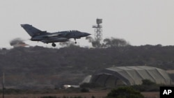 FILE - A warplane comes in to land after completing a mission at Britain's Royal Air Force Base in Akrotiri near the southern city of Limassol, Cyprus, Sept. 27, 2014.
