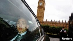 FILE - Mark Sedwill leaves the Houses of Parliament in London, July 8, 2014.