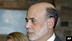 Federal Reserve chairman Ben Bernanke and his wife Anna arrive at an evening reception and dinner at the inaugural event of the annual Economic Policy Symposium at Jackson Hole in Moran, Wyoming, August 25, 2011