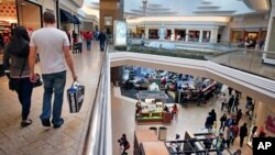 Shoppers troll for sales at Cherry Creek Mall, in Denver, Colorado, Nov. 29, 2013.