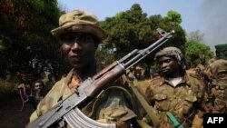 A picture taken on January 10, 2013 shows Seleka rebel coalition members take up positions in a village 12 kilometers from Damara, where troops of the regional African force FOMAC are stationed.