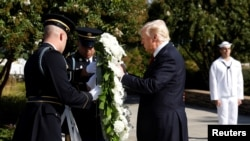 U.S. President Donald Trump lays a wreath during the 9/11 observance at the National 9/11 Pentagon Memorial in Arlington, Virginia, Sept. 11, 2017.