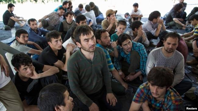 资料照片:泰国警方在泰国和马来西亚边境地区拘留了大约200名新疆维吾尔人(2014年3月14日)