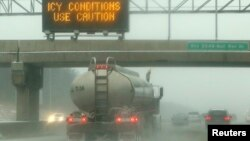 A sign warns drivers of icy conditions on Interstate 66 in Manassas, Virginia, outside of Washington December 8, 2013.