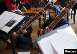 Members of the Zohra orchestra, an ensemble of 35 women, attend a rehearsal at Afghanistan's National Institute of Music, in Kabul, April 4, 2016.