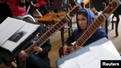 FILE - Members of the Zohra orchestra, an ensemble of 35 women, attend a rehearsal at Afghanistan's National Institute of Music, in Kabul, April 4, 2016.