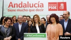 Andalusia's regional government acting president Susana Diaz (C) smiles as she gives a news conference with party members in the Andalusian capital of Seville, Spain, March 23, 2015.