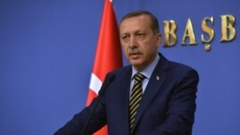 Turkey's Prime Minister Recep Tayyip Erdogan announces his new ministers in Ankara, Turkey, late Wednesday, Dec. 25, 2013.