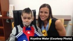 Kolya Ukrayna əsilli amerikalı paralimpiya çempionu Oksana Masterslə birlikdə