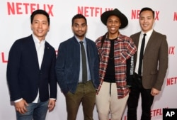 """Aziz Ansari, second from left, the star, writer, director and co-creator of the Netflix series """"Master of None,"""" poses with cast members, Kelvin Yu, left, and Lena Waithe, second right, and co-creator/executive producer Alan Yang, right, at a screening of of the show at The Paley Center, May 18, 2016, in Beverly Hills, California."""