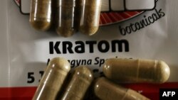 In this photo illustration, capsules of the herbal supplement kratom are seen in Miami, Fla., May 10, 2016.