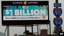 A digital billboard along I-90/94 highway in Chicago, displays the estimated Mega Millions jackpot, Oct. 19, 2018.