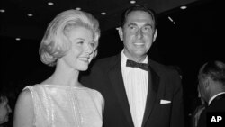 """FILE - In this April 4, 1960, photo, Doris Day, a best actress of the year nominee for her role in """"Pillow Talk,"""" and her producer husband Marty Melcher, arrive for the annual Academy Award presentations at the Pantages Theater in Los Angeles."""