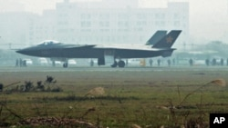 An aircraft that is reported to be a Chinese stealth fighter is seen in Chengdu, Sichuan province, in this picture released by Kyodo news agency on 8 Jan 2011.