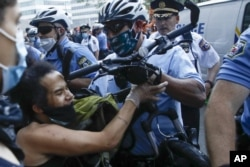 Philadelphia police confront protesters during the Justice for George Floyd Philadelphia Protest on Saturday, May 30, 2020.