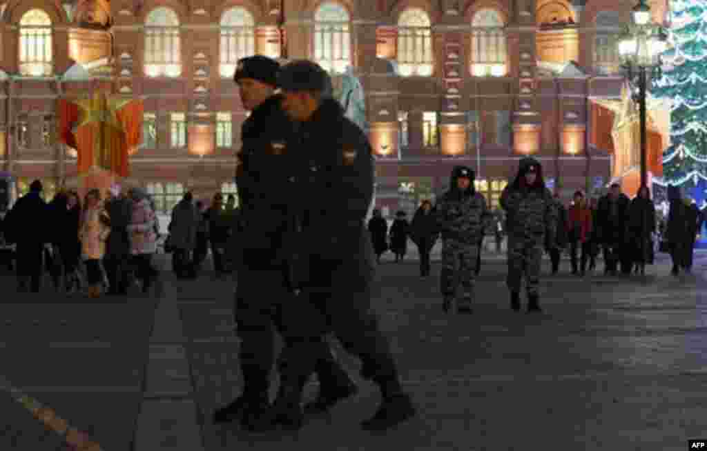 Russian police patrol on Manezhnaya square outside the Kremlin in Moscow, Thursday, Dec. 8, 2011. Moscow has already put about 50,000 police and 2,000 paramilitary troops on the streets, backed by water cannon. Prime Minister Vladimir Putin warned that th