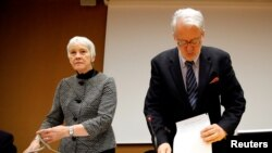 FILE - Paulo Pinheiro, Chairperson of the Commission of Inquiry on Syria, arrives with Karen Abuzayd, member of the Commission before the launch of their report on sexual and gender-based violence in Syria at the United Nations office in Geneva, Switzerland, March 15, 2018.