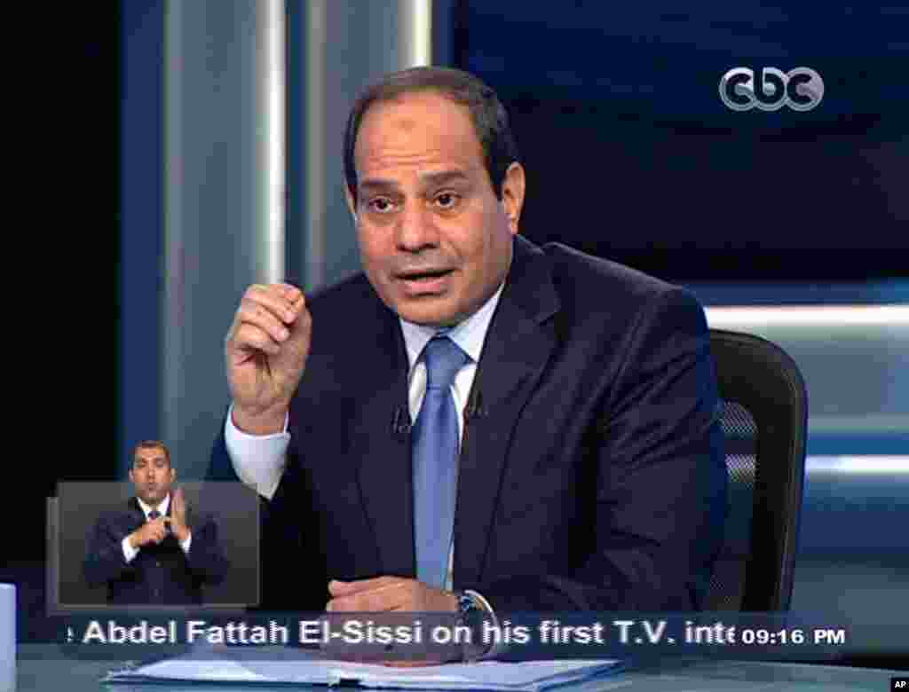 Former army chief Abdel-Fattah el-Sissi listens to a question during an interview in a nationally televised program on Egypt's State Television, in Cairo, May 5, 2014.