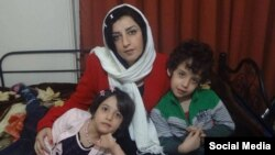 Narges Mohammadi, an Iranian human rights advocate, who is serving her jail term, is seen along with her two children in their home in Tehran.