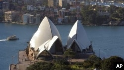 This recent photo shows Sydney's famous landmark, the Sydney Opera House (C), with the Royal Botanic Gardens and Government House (below).