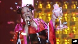FILE - Netta Barzilai from Israel celebrates after winning the Eurovision song contest in Lisbon, Portugal, May 12, 2018. When the United States recognized Jerusalem as Israel's capital, Israelis hoped other countries would follow suit. Instead, the move has created a backlash. The Eurovision song contest has become the latest battleground between Israel and boycott activists, threatening the contested city's hopes of hosting the 2019 Eurovision song contest.