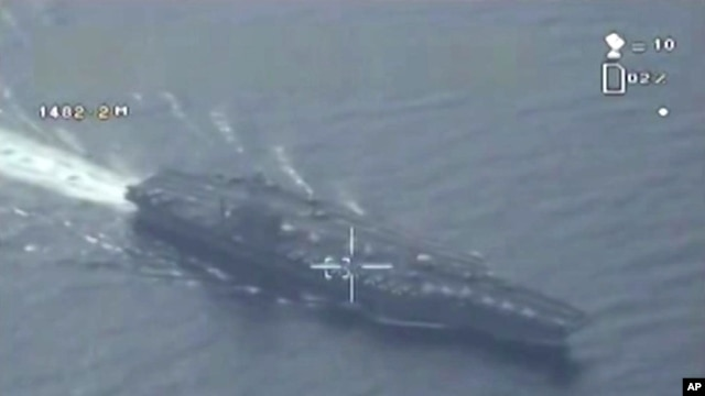 This still image made from video broadcast on Iranian state television, Jan. 29, 2016, shows what purports to be drone footage of a U.S. aircraft carrier.
