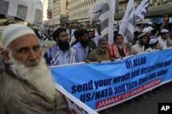 Supporters of a Pakistani religious party rally to condemn NATO's burning of Qurans in Afghanistan by NATO, in Karachi, Pakistan.