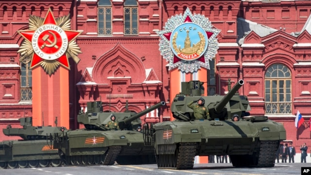 FILE - New Russian Armata tanks roll during the Victory Parade marking the 70th anniversary of the defeat of the Nazis in World War II, in Red Square in Moscow, May 9, 2015.