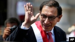 Peru's President Martin Vizcarra waves as he makes his way to the House of Pizarro, the presidential residence and workplace, in Lima, Peru, March 23, 2018. Vizcarra was sworn in, taking over from his predecessor, Pedro Pablo Kuczynski, who resigned over corruption allegations.