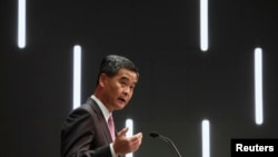 Hong Kong Chief Executive Leung Chun-ying speaks during a news conference following his maiden policy address in Hong Kong, January 16, 2013 file photo.