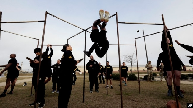 In this Jan. 8, 2019, photo, U.S Army troops training to serve as instructors participate in the new Army combat fitness test at the 108th Air Defense Artillery Brigade compound at Fort Bragg, N.C. (AP Photo/Gerry Broome)
