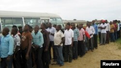 FILE - Former Nigerian militants queue to register at an arms collection center in Ogoloma-Okrika district, around 50 km (30 miles) east of the oil hub Port Harcourt.