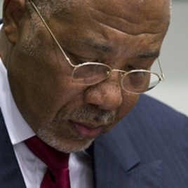 Former Liberian President Charles Taylor looks down as he waits for the start of a hearing to deliver verdict in the court room of the Special Court for Sierra Leone in Leidschendam, near The Hague, Netherlands, April 26, 2012.