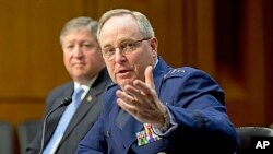 The Senate Armed Services Committee hears from top officials of the Air Force, Air Force Chief of Staff Gen. Mark A. Welsh III, (r) and Secretary of the Air Force Michael B. Donley, during a hearing on Capitol Hill in Washington, May 7, 2013.