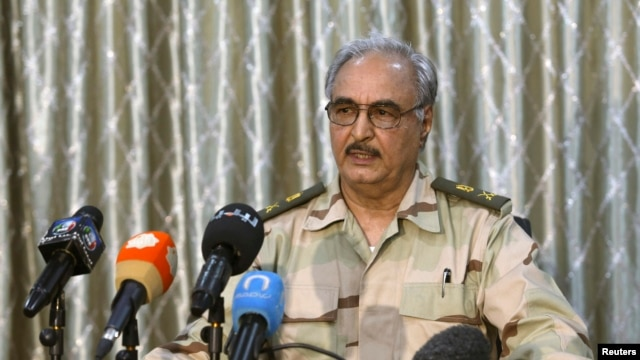 FILE - General Khalifa Haftar speaks during a news conference at a sports club in Abyar, a small town to the east of Benghazi.