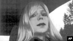 FILE - In this undated file photo provided by the U.S. Army, Pfc. Chelsea Manning poses for a photo wearing a wig and lipstick. Attorneys for the transgender soldier imprisoned in Kansas for sending classified information to the anti-secrecy website WikiLeaks.