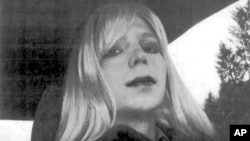 FILE - In this undated file photo provided by the U.S. Army, Pfc. Chelsea Manning poses for a photo wearing a wig and lipstick. Attorneys for the transgender soldier imprisoned in Kansas for sending classified information to the anti-secrecy website WikiL