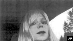 FILE - In this undated file photo provided by the U.S. Army, Pfc. Chelsea Manning poses for a photo wearing a wig and lipstick. Attorneys for the transgender soldier imprisoned in Kansas for sending classified information to the anti-secrecy website WikiLeaks said Monday, July 11, 2016, her hospitalization last week was due to an attempted suicide.