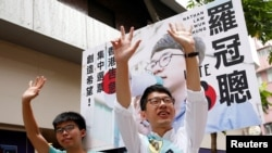 Nathan Law, (R), candidate from Demosisto and student activist Joshua Wong greet supporters on election day for the Legislative Council in Hong Kong, China, Sept. 4, 2016.