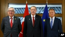 Turkey's President Recep Tayyip Erdogan, center, poses with European Council President Donald Tusk, right, and European Commission President Jean-Claude Juncker prior to their meeting in Brussels, Belgium, May 25, 2017. Erdogan is in Brussels to attend a NATO meeting.