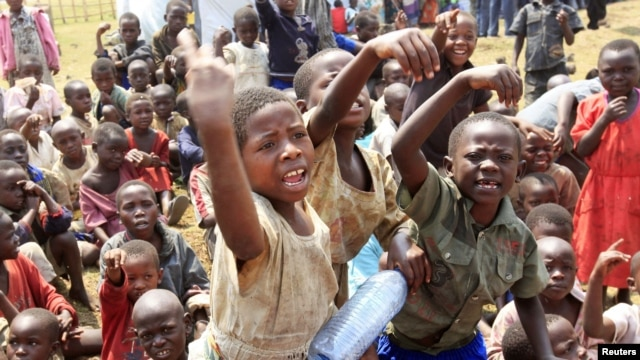 Refugee children, displaced by continued fighting in north Kivu province in the Democratic Republic of Congo (DRC), play at the Nyakabande refugee transit camp in Kisoro, Uganda, July 13, 2012.