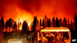 Firefighters arrive at Frenchman Lake to battle the Sugar Fire, part of the Beckwourth Complex Fire, burning in Plumas National Forest, California, July 8, 2021.