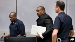 FILE - Jean-Pierre Bemba enters the courtroom of the International Criminal Court in The Hague, Netherlands, March 21, 2016. The court's judges handed him a guilty verdict.
