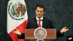 FILE - Mexico's President Enrique Pena Nieto gives an address in response to the U.S. presidential election in Mexico City.