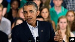 President Barack Obama speaks about affordable college education during a town hall meeting at Binghamton University in Vestal, New York, Aug. 23, 2013.