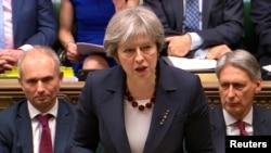 PM Inggris Theresa May memberikan pernyataan di depan parlemen Inggris di London, Rabu (14/3).