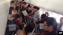 Members of the Philadelphia Orchestra performed on an airplane during a flight delay in Beijing in June.