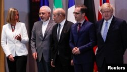 Britain's Foreign Secretary Boris Johnson, German Foreign Minister Heiko Maas, French Foreign Minister Jean-Yves Le Drian and EU High Representative for Foreign Affairs Federica Mogherini take part in meeting with Iran's Foreign Minister Mohammad Javad Zarif in Brussels, Belgium, May 15, 2018.