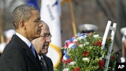 President Barack Obama and Iraq's PM Nouri al-Maliki lay a wreath at the Tomb of the Unknowns, Monday, at Arlington National Cemetery in Arlington, Virginia, Dec. 12, 2011