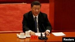 """中共领导人习近平2020年10月23日在纪念""""抗美援朝""""会议上发表讲话(路透社)"""